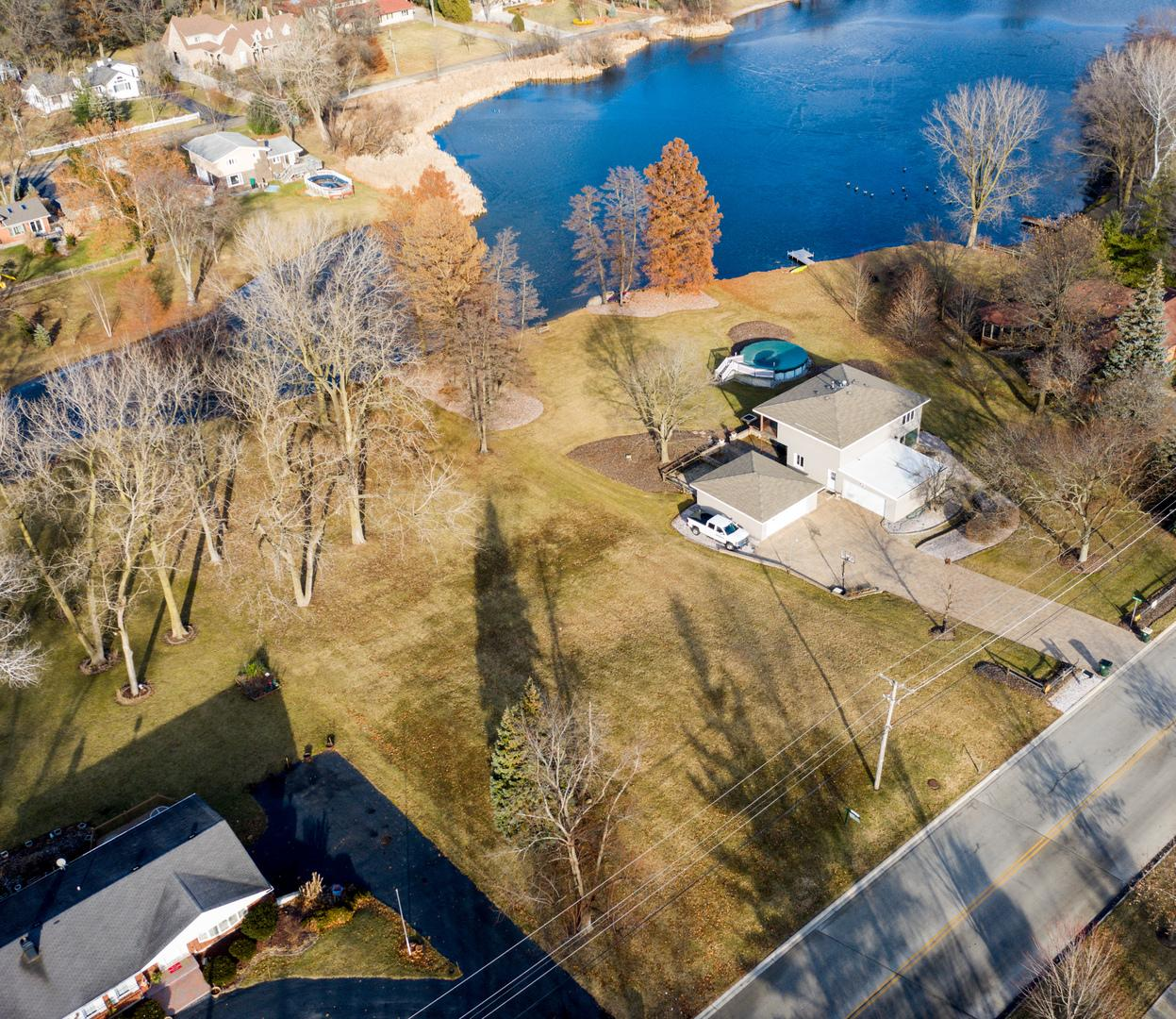 Beautifully Positioned Land on a 0.84-Acre Lot, Offers Impressive Views of a 5-Acre Spring-Fed Pond